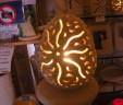 Lampada uovo disegno sole e buchi. Lavorazione Artigianale in Pietra Leccese